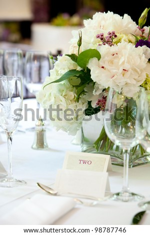 Table set for a wedding or other catered banquet - stock photo