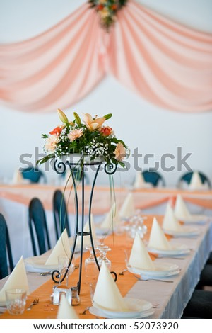 Table set for an event party or wedding reception DOF focus on bouquet - stock photo