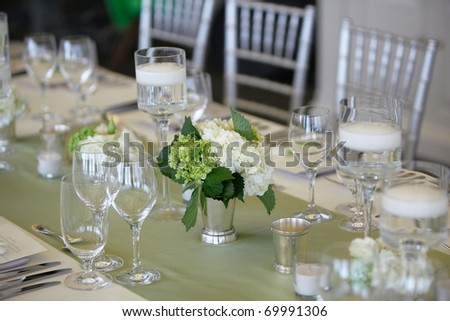 Table set for an event party or wedding reception, focus on bouquet - stock photo