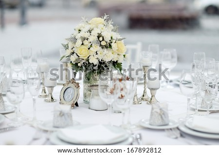Table set for an event party or wedding reception, winter theme - stock photo