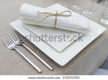table set for fine dining or another catered event - stock photo