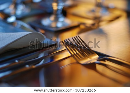 Table set for fine dining with cutlery and glassware - stock photo