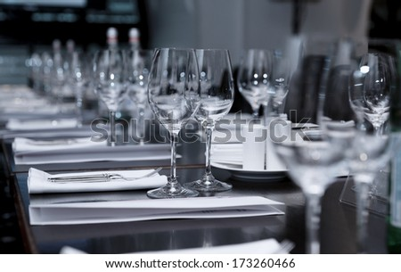 Table set for official dinner, focus on glasses - stock photo