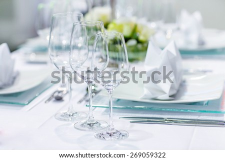 Table set in green and white for wedding or event party. Luxury decoration - stock photo