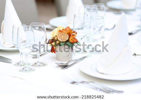 Table set in restaurant for wedding, family dinner or event party - stock photo
