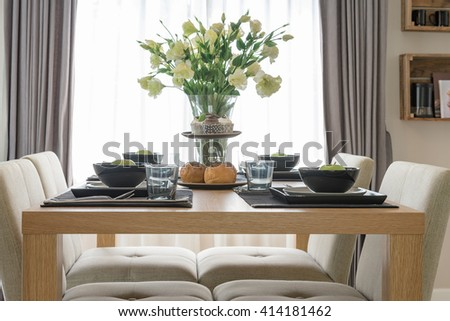 table set on wooden dinning table in modern dinning room design