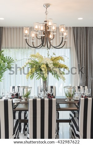 table set on wooden table in luxury dining room design