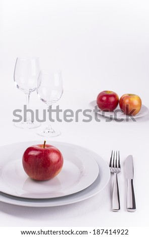 Table set with apples on white background for menu and invitation - stock photo