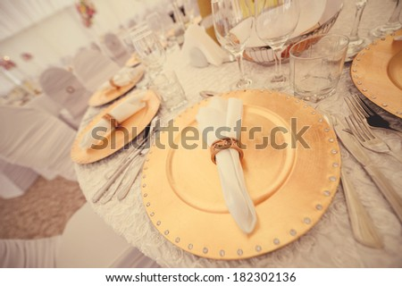 Table set with golden elements - stock photo