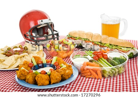 Table set with munchies for a Super Bowl party.  White background. - stock photo