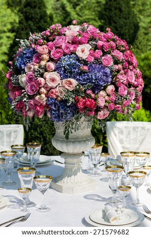 Table setting at a luxury wedding reception outdoors