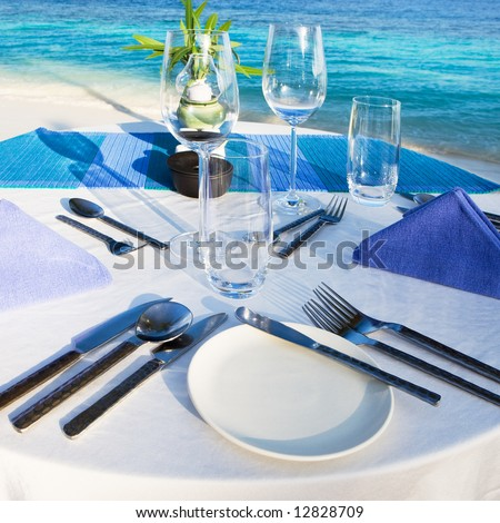 Table setting at beach restaurant - stock photo