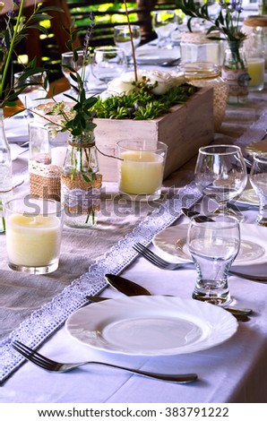 Table setting at wedding reception  in the open air.