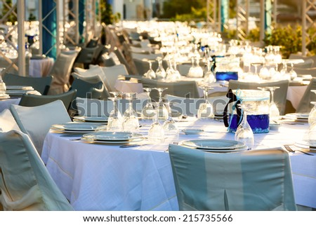 Table setting for an event party at outdoor cafe - stock photo