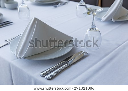Table setting in a restaurant - stock photo