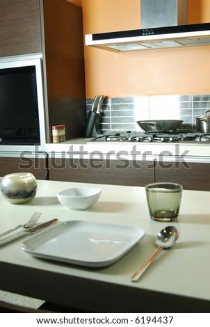 table setting in kitchen - stock photo
