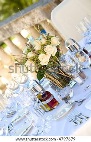 Table setting on a terrace for a wedding outdoors. - stock photo