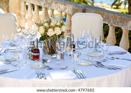 Table setting on a terrace for a wedding outdoors.