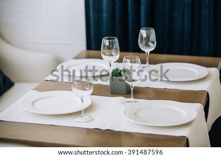 table setting, restaurant interior - stock photo