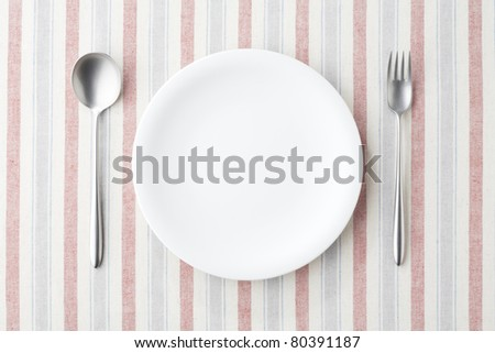 Table setting, spoon and fork - stock photo