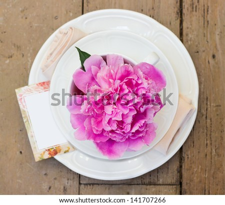 table setting with blooming pink peony. Shallow depth of field - stock photo
