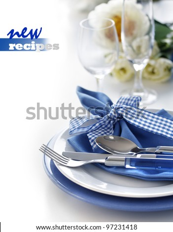 Table setting with blue dinner set - stock photo