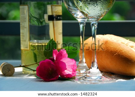 Table setting with chilled white wine and glasses alfresco, closeup - stock photo