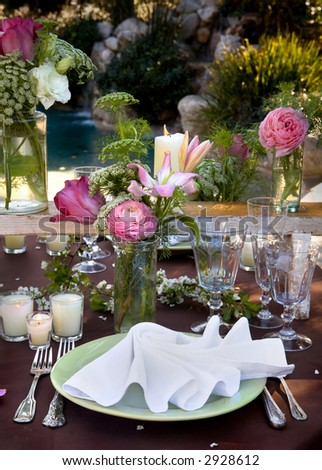 Table setting with floral arrangements - stock photo