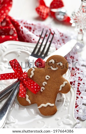 Table setting with gingerbread man for Christmas - stock photo