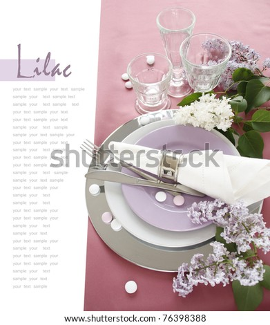 Table setting with lilac - stock photo