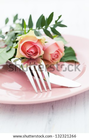 table setting with roses in pink - stock photo