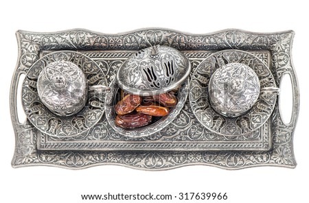 Table setting with silver tableware and dates. Oriental hospitality concept with tea or coffee cups. Top view - stock photo