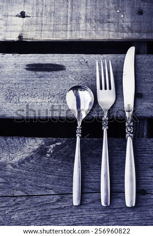 Table setting with vintage old cutlery on wooden table background, - stock photo