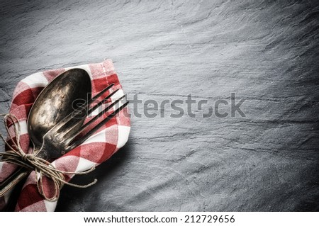 Table setting with vintage spoon and fork  - stock photo