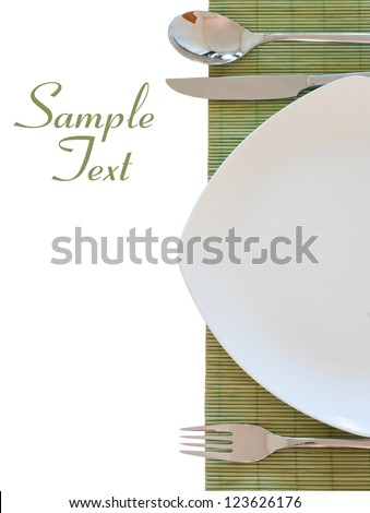 Table settings. Isolated on white background with sample text - stock photo