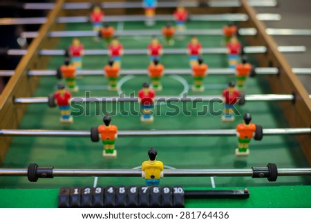 Table soccer from behind goal keeper command view angle - stock photo