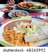 Table spread with tasty tacos,rice,beans, and salsa - stock photo