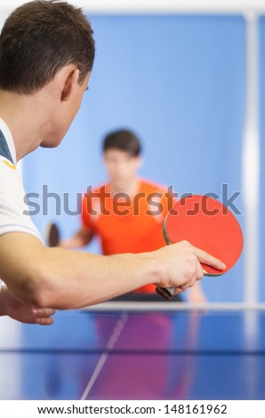 Table tennis game. Two young people playing table tennis - stock photo