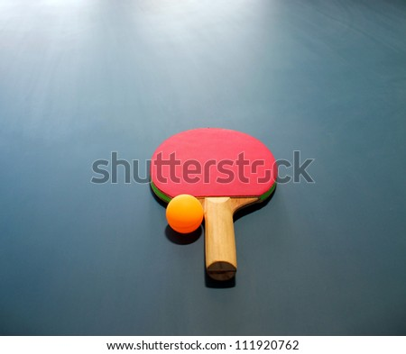 Table tennis paddle or racquet and ball
