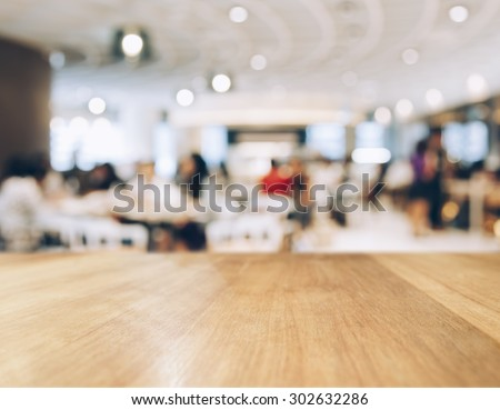Table top Counter with Blurred People and Restaurant Shop interior background - stock photo