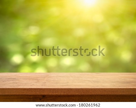 Table top on bokeh foliage with sun - stock photo