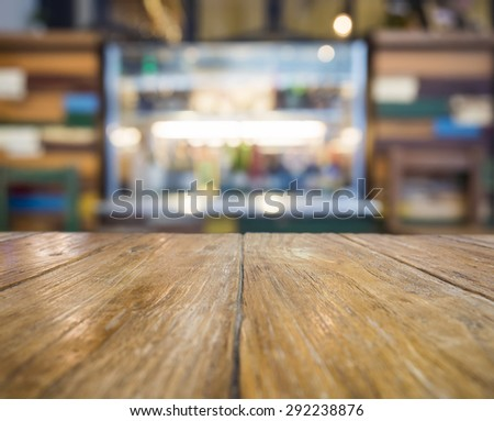 Table top with bar counter Blurred restaurant background for product display - stock photo