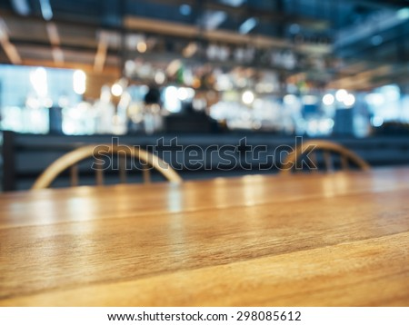 Table Top Wooden Counter with blurred Bar Restaurant background - stock photo