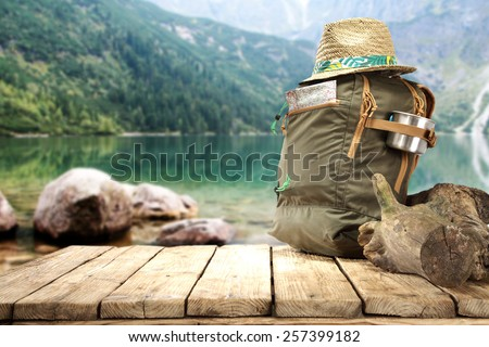table with backpack and hat  - stock photo