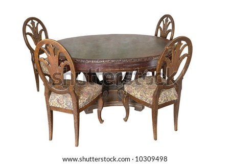 Table with chairs of 18 century. Beautiful craftsmanship example of German engravers on wood.