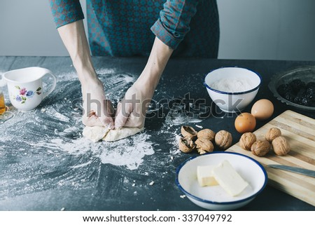 table with cookie cutter flour and various ingredients - stock photo