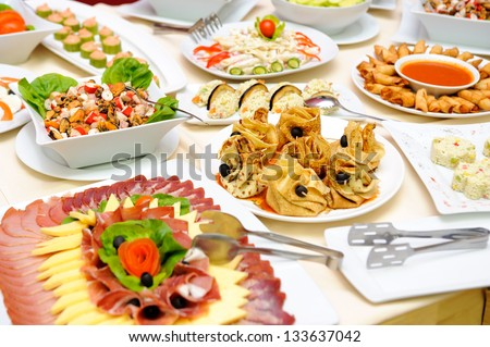Table with delicious food - stock photo