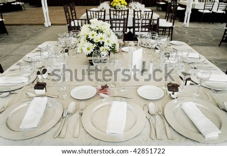 table with dishes and ornaments ready for a celebration - stock photo