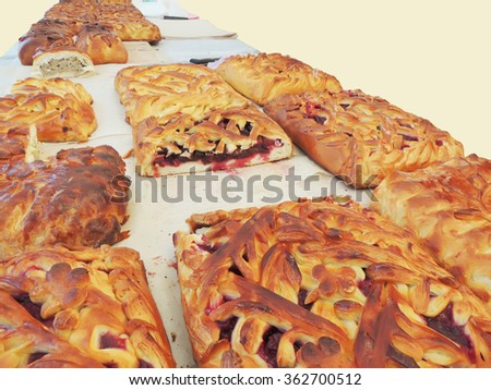 Table with fruit and meat pies - stock photo