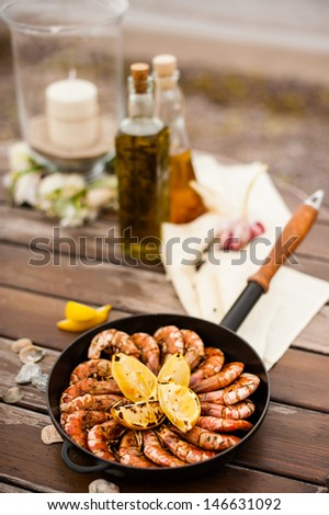table with grilled seafood - stock photo